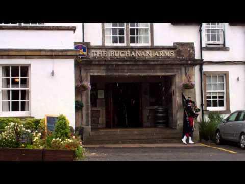 Scottish Wedding Piper In The Rain Outside Buchanan Arms Hotel Drymen Scotland July 28th
